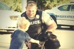 Officer with boy and dog [resized for blog].jpg